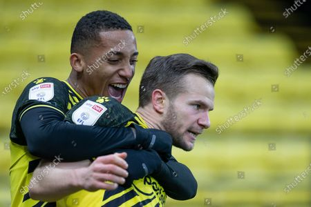 Goal scorer Tom Cleverley of Watford  celebrates with Joao Pedro of Watford