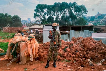 Ugandan security forces guards a checkpoint Kampala, Uganda, after Ugandan President Yoweri Kaguta Museveni was declared winner of the presidential elections