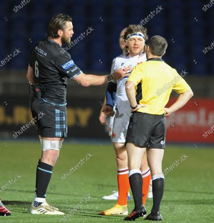 Ryan Wilson - Glasgow Warriors captain attempts to stop Hamish Watson speaking to referee Mike Adamson at the end of the match.