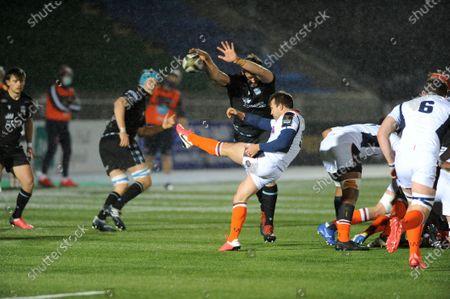 Nic Groom - Edinburgh scrum half gets his clearance kick charged down by Richie Gray - Glasgow lock.