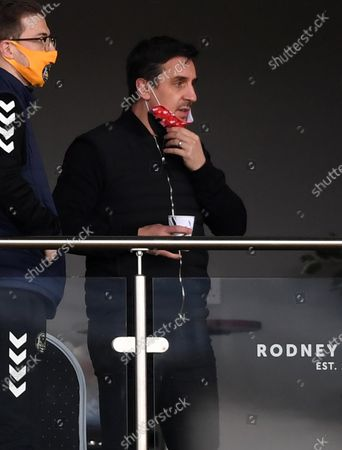 Salford City co-owner Gary Neville looks on.