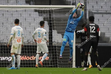 Marseille's goalkeeper Yohann Pele makes a save during the French League One soccer match between Marseille and Nimes at the Veledrome stadium in Marseille, France, Saturday, Jan.16, 2021