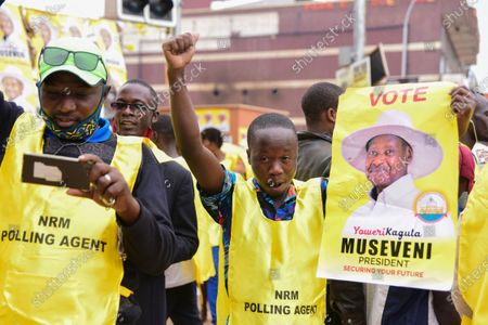 Supporters of incumbent Ugandan Presdent Yoveri Museveni and Uganda's National Resistance Movement (NRM) celebrate in the streets of Kampala, Uganda, 16 January 2021. Uganda's electoral commission announced Yoweri Museveni has won a sixth term in office with almost 60 percent of votes.