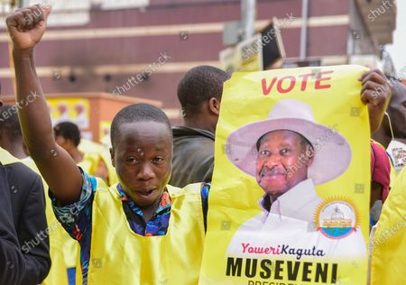 A supporter of incumbent Ugandan Presdent Yoveri Museveni and Uganda's National Resistance Movement (NRM) celebrates in the streets of Kampala, Uganda, 16 January 2021. Uganda's electoral commission announced Yoweri Museveni has won a sixth term in office with almost 60 percent of votes.