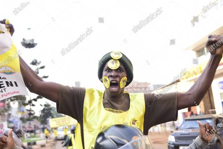 Supporter of Ugandan President Yoweri Kaguta Museveni celebrates, in Kampala, Uganda, after their candidate was declared winner of the presidential elections. Uganda's electoral commission says longtime President Yoweri Museveni has won a sixth term, while top opposition challenger Bobi Wine alleges rigging and officials struggle to explain how polling results were compiled amid an internet blackout. In a generational clash widely watched across the African continent, the young singer-turned-lawmaker Wine posed arguably the greatest challenge yet to Museveni