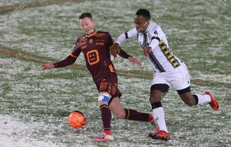 Mechelen's Rob Schoofs and Charleroi's Saido Berahino fight for the ball during a soccer match between Sporting Charleroi and KV Mechelen, Saturday 16 January 2021 in Charleroi, on day 20 of the 'Jupiler Pro League' first division of the Belgian championship.