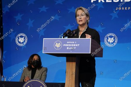 President-elect Joe Biden's nominee to co-chair the President's Council of Advisors on Science and Technology Frances Arnold speaks during an event at The Queen theater, in Wilmington, Del. Vice President-elect Kamala Harris listens at left