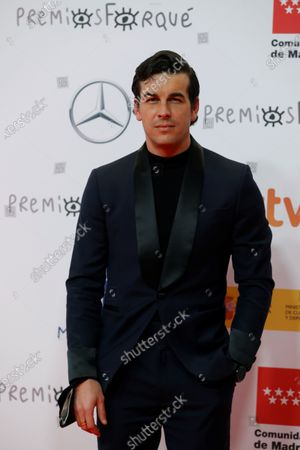 Mario Casas poses upon his arrival at the Forque Awards Ceremony at Ifema Pavillion in Madrid, Spain, 16 January 2021.