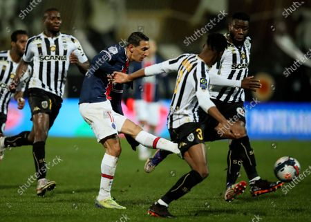 PSG's Angel Di Maria, centre, kicks the ball during the French League One soccer match between Angers and Paris Saint-Germain at Jean-Bouin stadium in Angers, France
