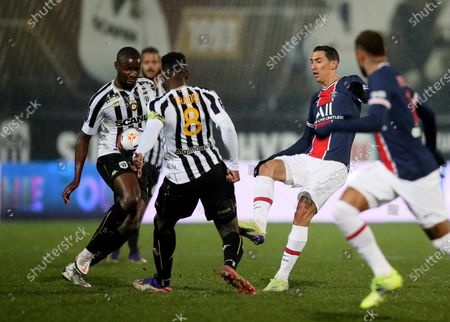 PSG's Angel Di Maria, second right, kicks the ball during the French League One soccer match between Angers and Paris Saint-Germain at Jean-Bouin stadium in Angers, France