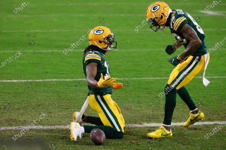 Green Bay Packers' Davante Adams, left, celebrates after scoring with Marquez Valdes-Scantling after a touchdown during the first half of an NFL divisional playoff football game against the Los Angeles Rams, in Green Bay, Wis