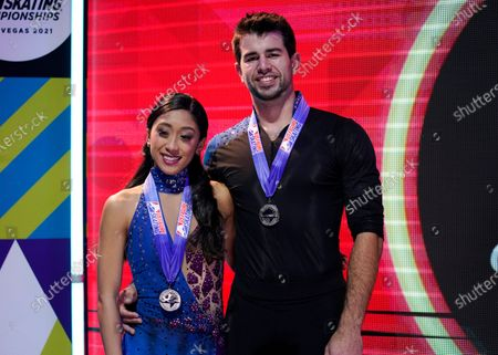 Second-place finishers Jessica Calalang and Brian Johnson pose with their medals in the championship pairs at the U.S. Figure Skating Championships, in Las Vegas