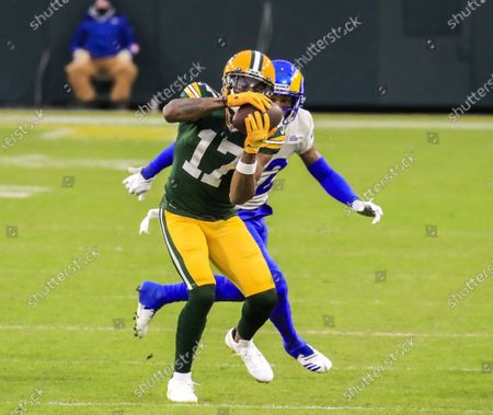 Green Bay Packers wide receiver Davante Adams (L) catches a pass in front of Los Angeles Rams cornerback Troy Hill (R) during the NFL Divisional playoff game between the Los Angeles Rams and the Green Bay Packers at Lambeau Field in Green Bay, Wisconsin, USA, 16 January 2021.