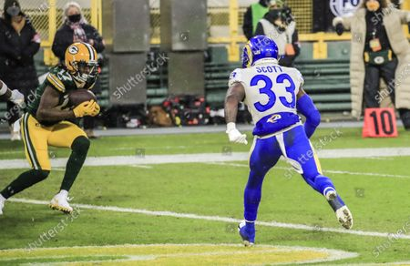 Green Bay Packers wide receiver Davante Adams (L) catches a touchdown pass as Los Angeles Rams safety Nick Scott (R) is unable to stop the play during the NFL Divisional playoff game between the Los Angeles Rams and the Green Bay Packers at Lambeau Field in Green Bay, Wisconsin, USA, 16 January 2021.