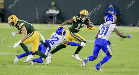 Green Bay Packers wide receiver Davante Adams (17) runs with the ball against the Los Angeles Rams during the fourth quarter of the Divisional Playoff at Lambeau Field in Green Bay, Wisconsin, on Saturday, January 16, 2021. The Green Bay Packers defeated the Los Angeles Rams 32-18.