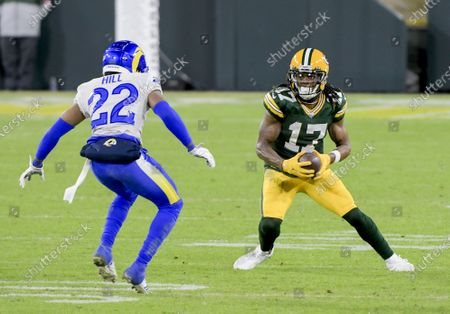 Los Angeles Rams cornerback Troy Hill (22) looks to tackle Green Bay Packers wide receiver Davante Adams (17) during the fourth quarter of the Divisional Playoff at Lambeau Field in Green Bay, Wisconsin, on Saturday, January 16, 2021. The Green Bay Packers defeated the Los Angeles Rams 32-18.