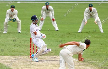 India's Washington Sundar avoids a bouncer from Australia's Mitchell Starc during play on day three of the fourth cricket test between India and Australia at the Gabba, Brisbane, Australia
