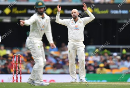 Nathan Lyon (R) of Australia is seen reacting during day three of the fourth Test Match between Australia and India at the Gabba in Brisbane, Australia, 17 January 2021.