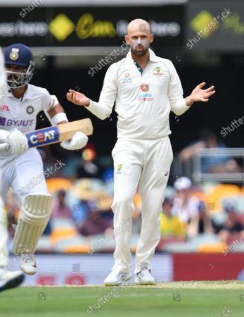 Nathan Lyon of Australia is seen reacting during day three of the fourth Test Match between Australia and India at the Gabba in Brisbane, Australia, 17 January 2021.