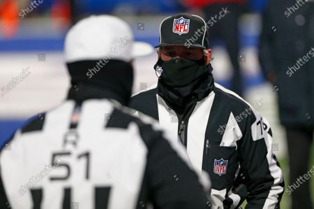 Referee Greg Meyer (78) talks to referee Carl Cheffers (51) before an NFL divisional round football game between the Buffalo Bills and the Baltimore Ravens, in Orchard Park, N.Y