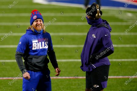 Buffalo Bills wide receiver Cole Beasley, left, talks to Baltimore Ravens wide receiver Dez Bryant before an NFL divisional round football game, in Orchard Park, N.Y