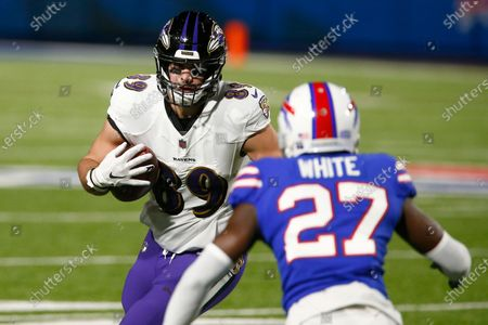 Baltimore Ravens tight end Mark Andrews (89) runs toward Buffalo Bills cornerback Tre'Davious White (27) during the first half of an NFL divisional round football game, in Orchard Park, N.Y