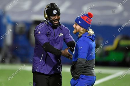 Stock Photo of Baltimore Ravens' Dez Bryant, left, talks to Buffalo Bills' Cole Beasley before an NFL divisional round football game, in Orchard Park, N.Y