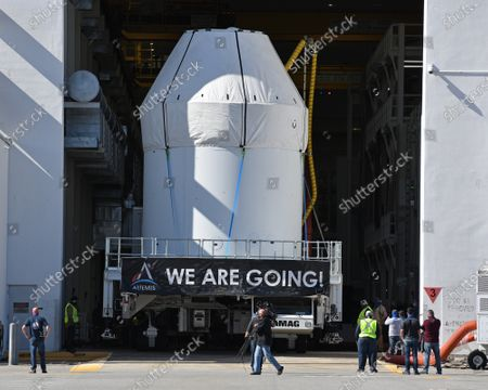 Wrapped in a protective covering, NASA's Orion spacecraft sitting on top of its Service Module is rolled out from the Neil Armstrong Operations and Checkout (O&C) Building  at the Kennedy Space Center, Florida on Saturday, January 16, 2021. The spacecraft is planned for an unmanned mission later this year. With NASA's Artemis program, a similar Orion craft is scheduled  to carry astronauts to the Moon by 2024.