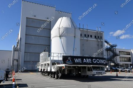 Stock Image of Wrapped in a protective covering, NASA's Orion spacecraft sitting on top of its Service Module is rolled out from the Neil Armstrong Operations and Checkout (O&C) Building  at the Kennedy Space Center, Florida on Saturday, January 16, 2021. The spacecraft is planned for an unmanned mission later this year. With NASA's Artemis program, a similar Orion craft is scheduled  to carry astronauts to the Moon by 2024.