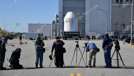 Media photographers document NASA's Orion spacecraft as it is rolled out from the Neil Armstrong Operations and Checkout (O&C) Building  at the Kennedy Space Center, Florida on Saturday, January 16, 2021. The spacecraft is planned for an unmanned mission later this year. With NASA's Artemis program, a similar Orion craft is scheduled  to carry astronauts to the Moon by 2024.