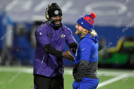 Baltimore Ravens' Dez Bryant, left, talks to Buffalo Bills' Cole Beasley before an NFL divisional round football game, in Orchard Park, N.Y