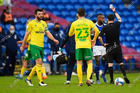 Cardiff player Leandro Bacuna receives a yellow card from referee Tony Harrington