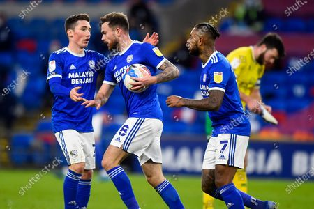 Cardiff player Joe Ralls celebrates with Harry Wilson and Leandro Bacuna after scoring his sides first goal of the game mid way through the second half