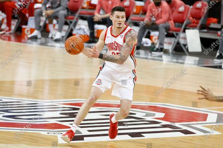 Ohio State's Kyle Young plays against Northwestern during an NCAA college basketball game, in Columbus, Ohio