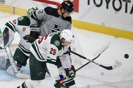 Stock Picture of Los Angeles Kings center Trevor Moore, top, and Minnesota Wild defenseman Jonas Brodin battle for the puck during the second period of an NHL hockey game in Los Angeles