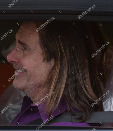 Exclusive - Fabio Lanzoni smiles out of his car window in Brentwood