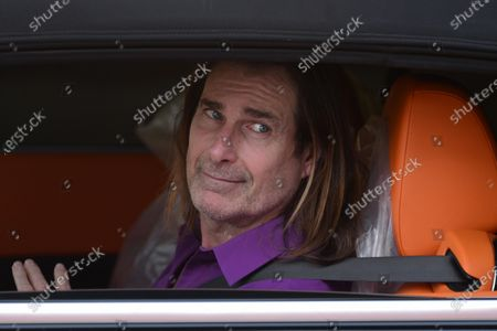 Stock Picture of Exclusive - Fabio Lanzoni smiles out of his car window in Brentwood