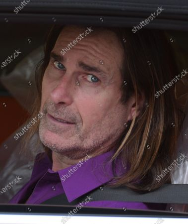 Stock Photo of Exclusive - Fabio Lanzoni smiles out of his car window in Brentwood