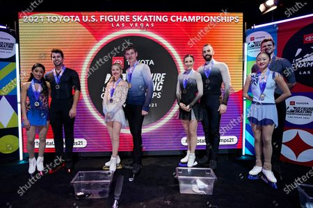 From left, second place finishers Jessica Calalang and Brian Johnson, first place finishers Alexa Knierim and Brandon Frazier, third place finishers Ashley Cain-Gribble and Timothy LeDuc and fourth place finishers Audrey Lu and Misha Mitrofanov pose with their medals in the championship pairs at the U.S. Figure Skating Championships, in Las Vegas