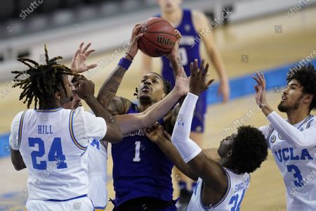 Stock Image of Washington forward Nate Roberts (1) takes a shot against UCLA forward Jalen Hill (24) and UCLA guard David Singleton (34) during the first half of an NCAA college basketball game, in Los Angeles