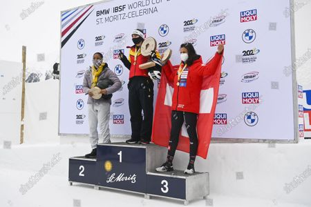 (L-R) second placed Elana Meyers Taylor of USA, winner Stephanie Schneider of Germany, and third placed Melanie Hasler of Switzerland celebrate on the podium for the Women's two-woman race at the Bobsleigh World Cup in St. Moritz, Switzerland, 17 January 2021.