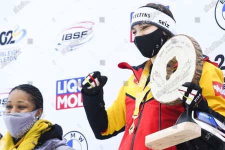 Stock Photo of Second placed Elana Meyers Taylor (L) of USA and Winner Stephanie Schneider of Germany celebrate on the podium for the Women's two-woman race at the Bobsleigh World Cup in St. Moritz, Switzerland, 17 January 2021.