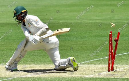 Nathan Lyon of Australia is clean bowled by Washington Sundar of India during day two of the fourth Test Match between Australia and India at the Gabba in Brisbane, Australia, 16 January 2021.