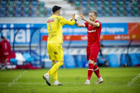 Antwerp's goalkeeper Alireza Beiranvand and Antwerp's Ritchie De Laet celebrate after winning a soccer match between KAA Gent and Royal Antwerp FC RAFC, Sunday 17 January 2021 in Gent, on day 20 of the 'Jupiler Pro League' first division of the Belgian championship.