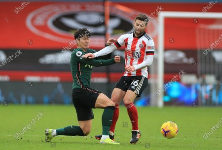 Oliver Norwood (R) of Sheffield in action against Son Heung-Min (L) of Tottenham during the English Premier League soccer match between Sheffield United and Tottenham Hotspur in Sheffield, Britain, 17 January 2021.