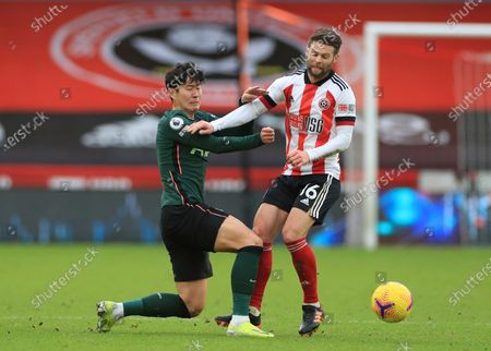 Stock Picture of Tottenham Hotspur's Son Heung-min, left, and Sheffield United's Oliver Norwood challenge for the ball during the English Premier League soccer match between Sheffield United and Tottenham Hotspur at the Bramall Lane stadium in Sheffield, England, Sunday, Jan.17, 2021
