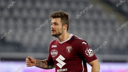 Stock Picture of Torino's Karol Linetty controls the ball during a Serie A soccer match between Tonino and Spezia, at the Olympic stadium in Turin, Italy
