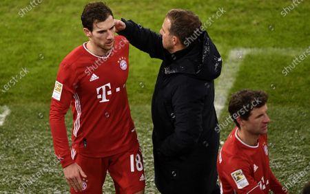 Bayern's Leon Goretzka (L), Bayern's Thomas Mueller (R) and Bayern's head coach Hansi Flick (C) react during the German Bundesliga soccer match between FC Bayern Muenchen and SC Freiburg at Allianz Arena in Munich, Germany, 17 January 2021.