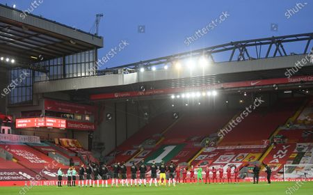 Stock Photo of Players of Liverpool (R) and Manchester United (L) applaud in memory of late Gerry Marsden prior to the English Premier League soccer match between Liverpool FC and Manchester United in Liverpool, Britain, 17 January 2021.