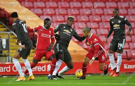 Liverpool players Sadio Mane (2-L) and Thiago Alcantara (2-R) in action against Paul Pogba (C) of Manchester United during the English Premier League soccer match between Liverpool FC and Manchester United in Liverpool, Britain, 17 January 2021.